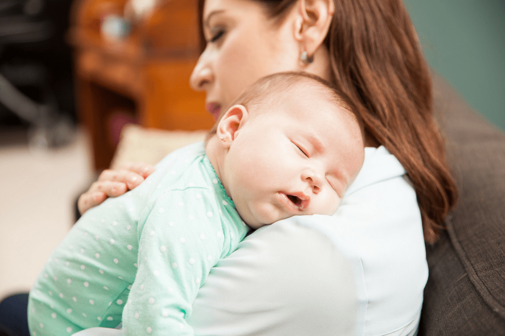 How to get more sleep with a newborn. Tips for new moms.